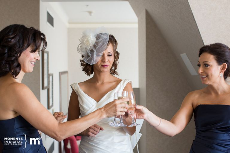 Bride Enjoying champagne with her bridesmaids