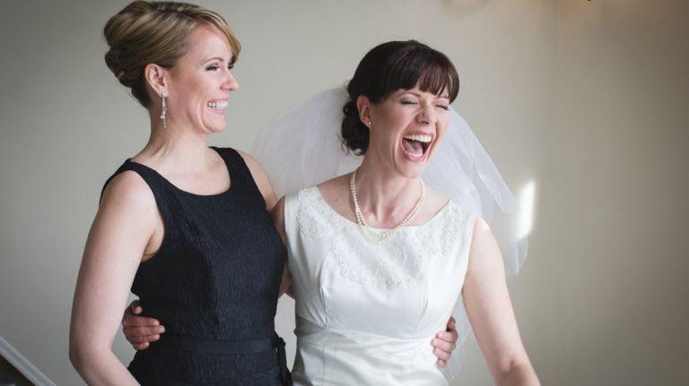 Bride & Bridesmaid share a laugh at the Fairmont Hotel MacDonald